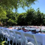 Party table and chair rental setup in phoenix backyard.